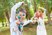 picture of battle  - Paintbrush battle between wife and husband on the forest background