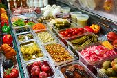stock photo of pickled vegetables  - Variety of pickled vegetables and mushrooms in a store