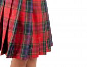 image of up-skirt  - Close up of a red skirt Scottish on white background - JPG
