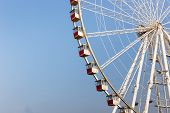 picture of ferris-wheel  - Big ferris wheel over blue sky with cabins - JPG