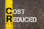 stock photo of reduce  - Concept image of Business Acronym CR as Cost Reduced written over road marking yellow paint line - JPG