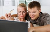 pic of antidepressant  - Family couple making shopping over internet looking in notebook and paying with credit card - JPG