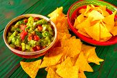 image of nachos  - Guacamole with avocado tomatoes and nachos mexican food - JPG