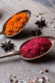 foto of saffron  - Different spices selection in old metal spoons over wooden background - JPG