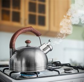 foto of boil  - kettle boiling on a gas stove in the kitchen - JPG