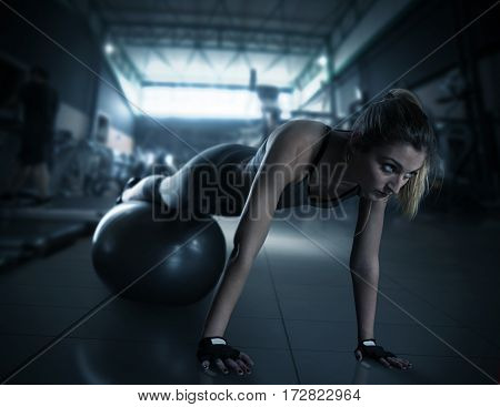 Muscular woman trains