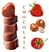 Photo-realistic vector illustration of chocolates. Heart-shaped chocolates with nuts and berries..