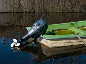 image of outboard engine  - small green motor boat with outboard motor - JPG