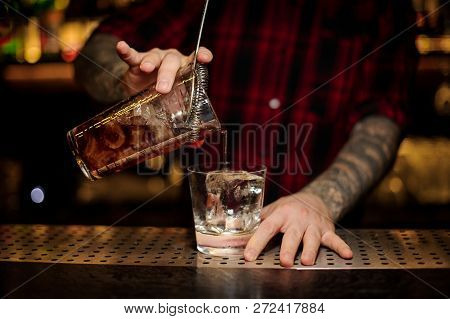 Bartender Pouring A Godfather Cocktail
