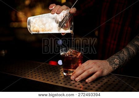 Bartender Pouring A Tasty Godfather