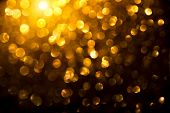 Christmas Gold glowing Background. Golden Holiday Abstract Glitter Defocused Backdrop With Blinking  poster