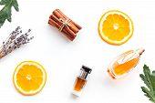 Sweet Perfume With Fruit Fragrance. Bottle Of Perfume Near Orange, Lavender, Cinnamon On White Backg poster