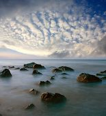 Stones in sea in evening time