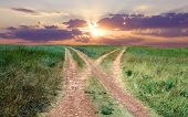 Countryside road on sunset background