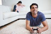 Man playing video games while his fiance is crying in their living room