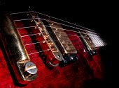 music concept with red electric guitar isolated on black background in dark
