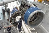 Technical Specialists And Aircraft Technicians Install The Reverse Engine After Scheduled Service. C poster