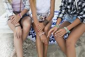 Summer Outdoor Shooting On The Beach, Three Girls In Shorts And Blouses With Tanned Bronze Skin Sitt poster