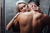 Affectionate Heterosexual Couple Hugging And Kissing While Taking Shower Together poster