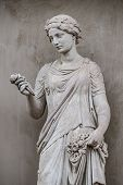 Ancient Statue Of Sensual Greek Renaissance Era Woman With A Flower, Potsdam, Germany, Details, Clos poster