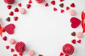 valentines day, sweets and romantic concept - close up of frosted cupcakes, red heart shaped chocola poster