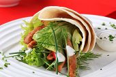 Chicken taco with vegetables, red background
