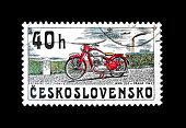 CZECHOSLOVAKIA - CIRCA 1975: A stamp printed in Czechoslovakia shows vintage Motorcycle JAWA 250 yea