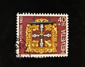 HELVETIA (SWITZERLAND) - CIRCA 1983: A Stamp printed in the HELVETIA shows religious symbolism , circa 1983.