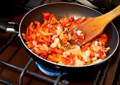Vegetables are fried in a pan