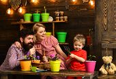 Garden Concept. Little Child Help Mother And Father Potting Flowers In New Pot, Garden. Home Garden. poster