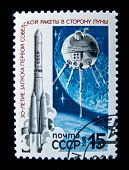 USSR - CIRCA 1989: A stamp printed in the USSR shows flight of Soviet missiles to Moon, circa 1989. Large space series