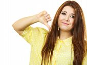 Negative Gestures Concept. Disappointed Young Woman Showing Thumb Down Hand Sign Gesture Looking Wit poster