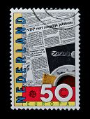 NETHERLANDS - CIRCA 1990s: A stamp printed in the Netherlands shows daily newspaper and morning cup