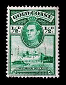 GOLD COAST - CIRCA 1940s: A stamp printed in Gold Coast shows portrait of King George 6th and Christiansborg Castle, circa 1940s