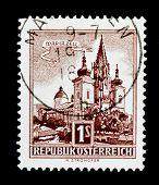 AUSTRIA - CIRCA 1957: A stamp (Scott 2008 620) printed in Austria shows image of the Austrian city Mariazell, series, circa 1957