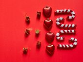 Christmas Candy Cane Drums Hearts And Gifts At Studio Above View Over A Red Background Isolated Flat poster