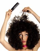 image of black curly hair  - woman with thick hair and comb - JPG