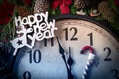 Wall Clock In Christmas And New Year Decorations Are Wrapped With Fir Branches And Christmas Decorat poster