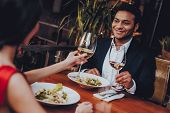 Cheerful Couple In Love Dating In Restaurant. Romantic Couple In Love Dating. Cheerful Man And Woman poster