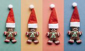 Set Of Christmas Gingerbread In The Form Of Little Ginger Men In A Red Hat On Colorful Backgrounds.  poster