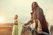 Medieval Knight With Lady On The Sunset Background. poster