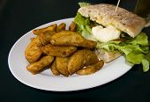 foccacia and chips served on a plate