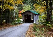 image of covered bridge  - a covered bridge in the autumn colors of vermont - JPG