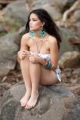 portrait of a beautiful young swimwear model outdoors posing in the rainforest