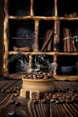 Hot Steaming Coffee Beans In Bowl On Rustic Wooden Background poster