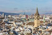 The City Of Zurich In Switzerland As Seen From The Tower Of The Grossmunster Cathedral In Winter, To poster