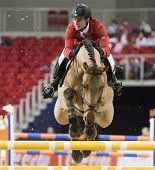 BUDAPEST, HUNGARY - DECEMBER 2: An unidentified competitor jumps with his horse at the OTP Equitatio