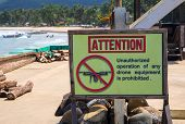 Attention Sign Prohibiting Drone Use By Sea. Unauthorized Operation Of Drone Is Prohibited Inscripti poster