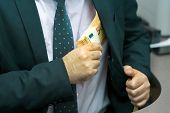 A Businessman Gives Euro A Bribe To An Employee In The Office. Concept - Corruption. Giving A Bribe. poster