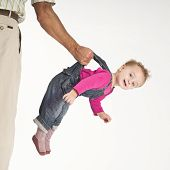 Father Holding Baby Toddler Suspended By Suspenders